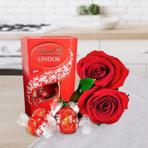Caixa de bombons Lindt e uma rosa vermelha